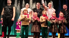 Participants of troupe on stage after christmas performance Stock Footage
