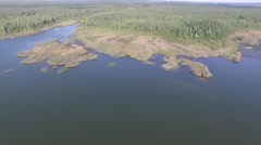 Flying over the lake and forest. Aerial survey Stock Footage