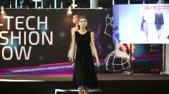 Girl in black dress on the hi-tech fashion show Stock Footage