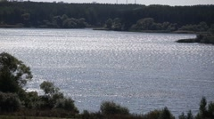 The water surface of the lake in the summer. Ripples on the water Stock Footage