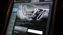 Control panel with drivers profiles in Tesla Model S Stock Footage