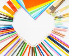Heart shape frame from pencils, felt-tip pens and paper Stock Photos