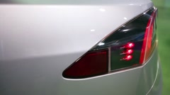 Electric car charge port located next to the taillight. Stock Footage