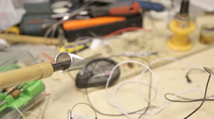 Soldering iron on the table Stock Footage