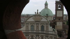 Zoom out Vigevano Cathedral from a hole in red bricks, Vigevano, PV, Italy Stock Footage