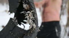 Closeup old used tire, which guy kicks training on sportsground Stock Footage