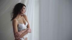 Woman posing near the window Stock Footage
