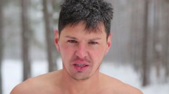Closeup bare-chested hatless man breathing hard after workout Stock Footage
