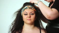 Girl model and visagiste working with her hair in studio. Stock Footage