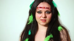 Smiling dark-haired girl model with feathers in hair. - stock footage