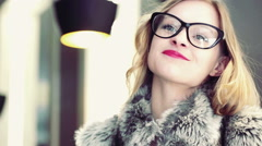 Attractive woman wearing grey fur and looking very happy Stock Footage