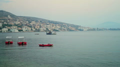 SARANDA CITY ALBANIA PASSING BOAT - stock footage