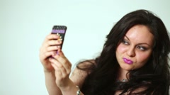 Dark-haired girl model makes selfies posing at studio. Stock Footage