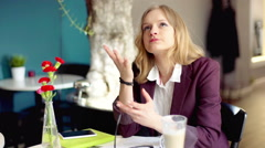 Irritated businesswoman checking time and waiting for someone in the cafe - stock footage