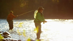 Skilled hobby female and male casting line freshwater fishing USA - stock footage