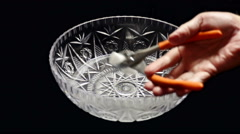 Super slow motion dropping dry ice with pliers into hot water - stock footage