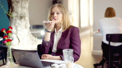 Businesswoman talking on loudspeaker in the cafe, steadycam shot - stock footage