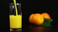 Man pouring orange juice into a glass Stock Footage