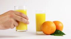 Man drinking orange juice Stock Footage
