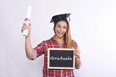 Young girl graduate with blackboard and diploma. Stock Photos