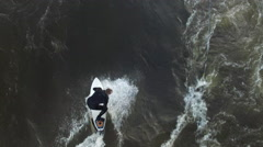 Extreme Sports Surfing on Standing wave in river - Aerial shot - stock footage