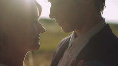 Two Lovers at Sunset Enjoying an Intimate Moment. Laughing Stock Footage