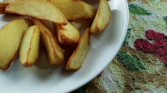 Fried potatoes with sauce on the white plate Stock Footage