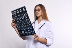 woman doctor with MRI scans. Isolated white background - stock photo