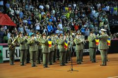 Beginning of a tennis match. Crowd singing national anthem - stock photo
