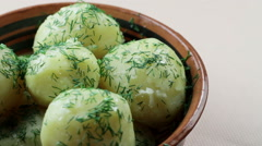 Cooked boiled potatoes with dill in a dish Stock Footage