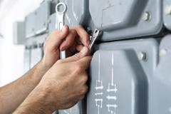 Electrical repair, switching current. Stock Photos
