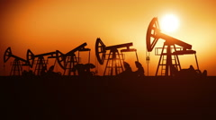 Oil Pumps in a Row at Sunset. Looped 3d animation Stock Footage
