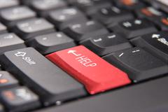 Red Help Key Button on Keyboard, closeup Stock Photos