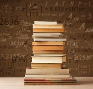 Books on vintage background with math formulas - stock photo