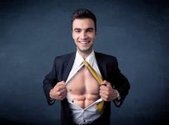Businessman tearing off shirt and showing mucular body Stock Photos