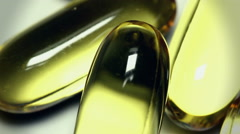Fish oil capsules omega  closeup shot. Stock Footage