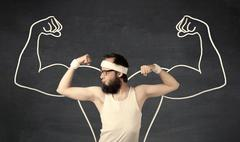 Young weak man with drawn muscles Stock Photos