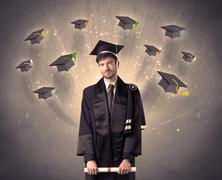 College graduate with many flying hats - stock photo