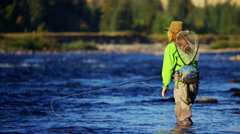 Skilled female casting line freshwater fishing USA Stock Footage