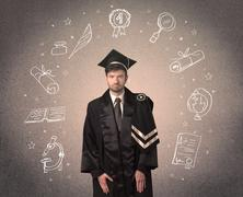 Happy graduate teenager with hand drawn school icons - stock photo