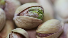 Salted pistachios. Macro in rotation. Stock Footage