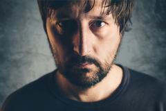 Dramatic low key portrait of adult male Stock Photos