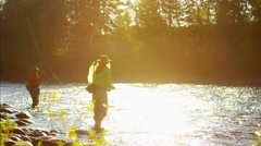 St Mary River male and female Freshwater fly fishing sunrise Canada Stock Footage