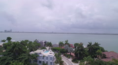 Aerial of San Marino Neighborhood of Miami, FL Revealing Ocean Stock Footage