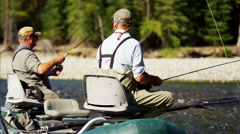 River dingy fly fishing males on freshwater river Wilderness area - stock footage
