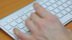Man typing on computer keyboard Stock Footage