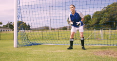 Goalkeeper in blue making a save Stock Footage