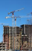 tower cranes on construction site - stock photo