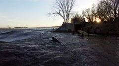 Ottawa River Surfing - Standing Wave Surfers in Wet suits in the spring Stock Footage