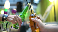 Woman drinking beer in the cafe with friends, steadycam shot Stock Footage